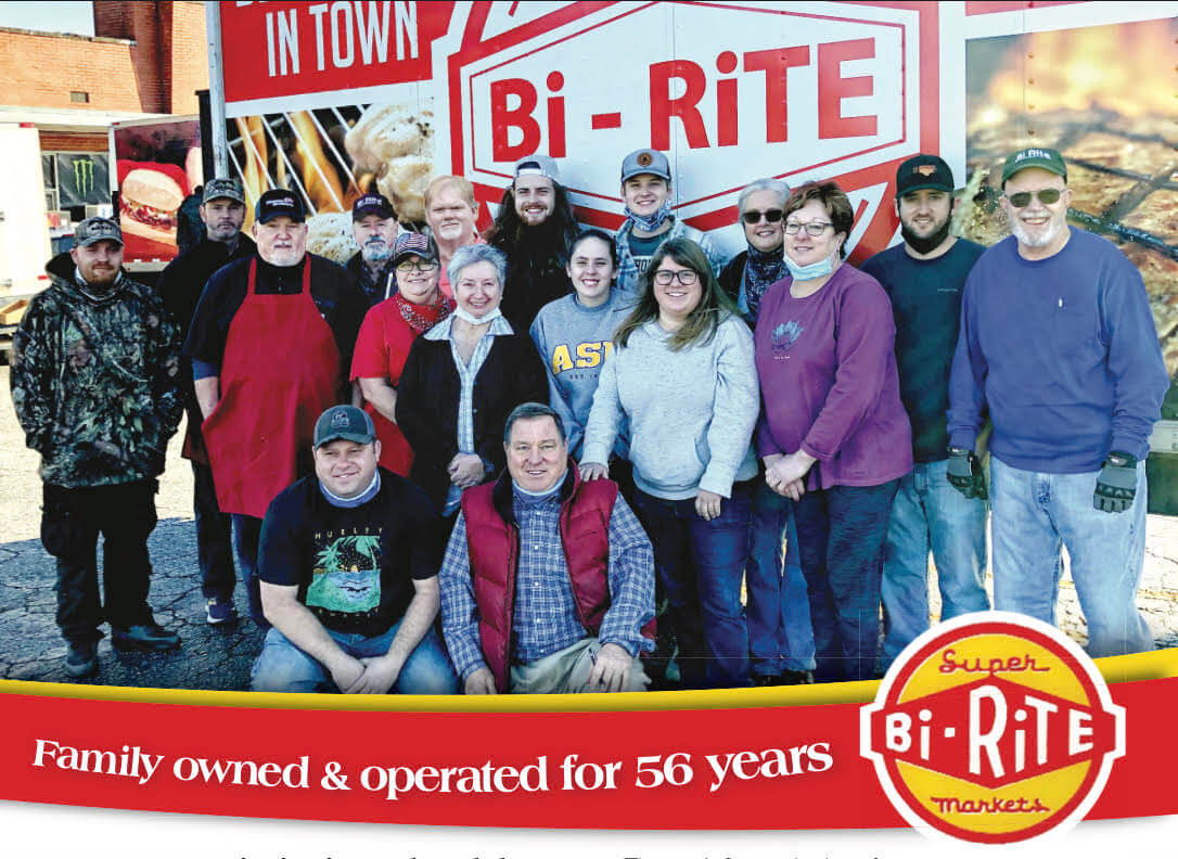 Store staff in front of Bi Rite truck